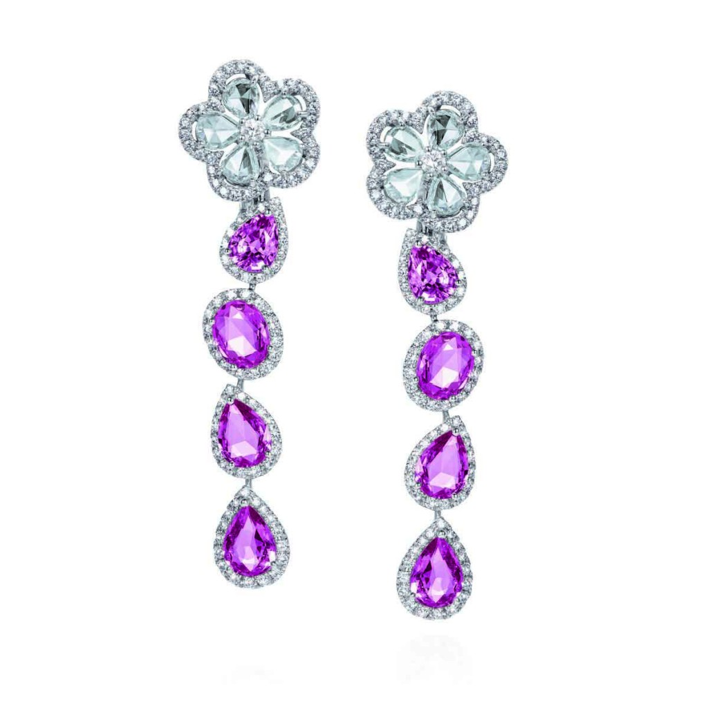 Set in white gold, and accented with pink sapphires (11.89 carats), rose cut diamonds (3.68 carat) and round brilliant-cut white diamonds (2.37 carats).
